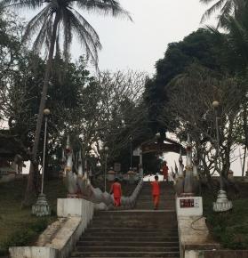 Lao Buddhist monks wearing the signature orange robes